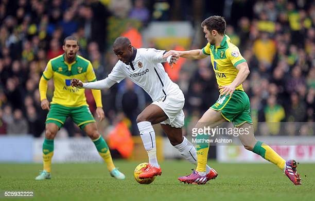 Benik Afobe of Wolverhampton Wanderers and Jonny Howson of Norwich City
