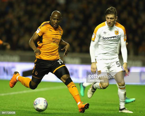 Benik Afobe of Wolverhampton Wanderers controls the ball watched by Angus MacDonald during the Sky Bet Championship match between Wolverhampton...