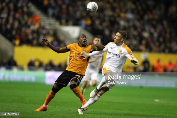 Benik Afobe of Wolverhampton Wanderers is challenged by Angus MacDonald of Hull City during the Sky Bet Championship match between Wolverhampton...