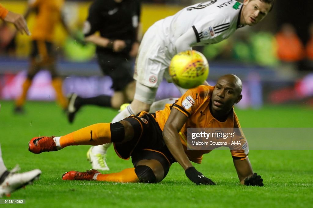Benik Afobe Of Wolverhampton Wanderers Is Fouled By