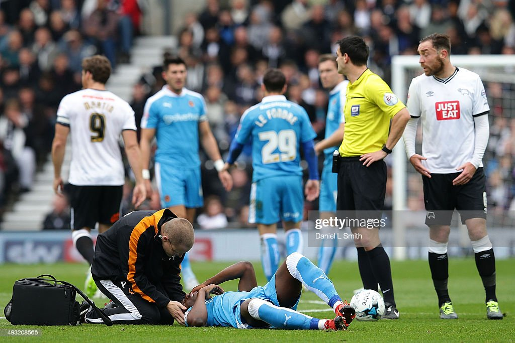 Benin Afobe of Wolverhampton Wanderers FC receives medical attention after suffering an impact to the head in a tackle during the Sky Bet Championship match between Derby County and Wolverhampton Wanderers at Pride Park Stadium on October 18, 2015 in Derby, England.