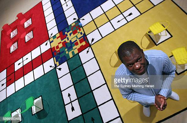 Benin artist Meschac Gaba with his installion for Biennale of a giant Ludo game entitled La Maison at the MCA 1 June 2006 SMH Picture by PETER MORRIS