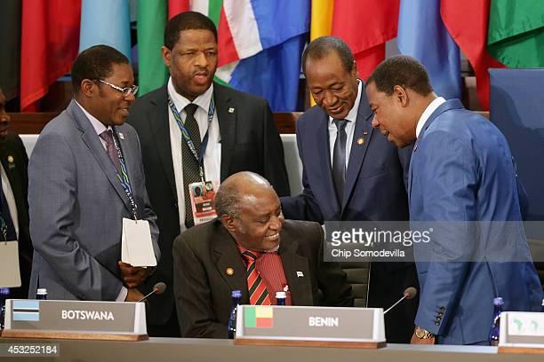 Benin President Boni Yayi and Burkina Faso President Blaise Copaore visit with Botswana Foreign Minister PhAndu Tombola Chanda Skelemani before the...