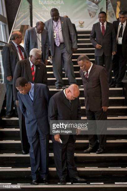 Benin President Boni Yayi and South African President Jacob Zuma stand with other delegates on the stairs of the Sandton Convention Centre where the...