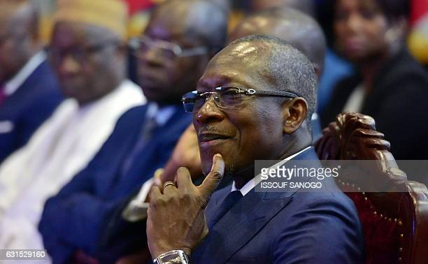 Benin President Patrice Talon listens during his visit at the Regional stock exchange in Abidjan on January 11 2017 / AFP / ISSOUF SANOGO