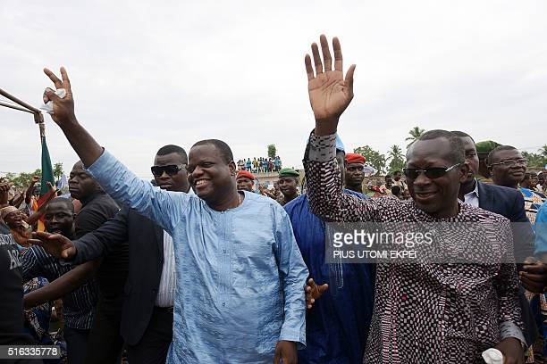 Benin presidential candidate and leader of coalition of the opposition Patrice Talon and food magnate Sebastien Ajavon wave to supporters during a...