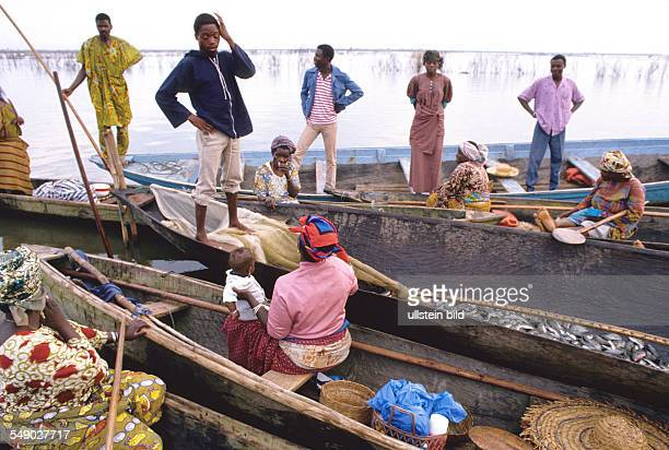 The fishermen sell their fish to their wives who will sell them on the market in Ganvie
