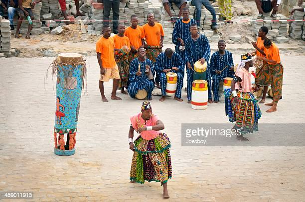 benin tour ship welcoming performers - traditional musician stock photos and pictures