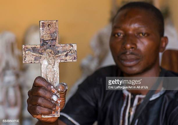 Benin West Africa Bonhicon kagbanon bebe priest holding a crucifix during a voodoo ceremony