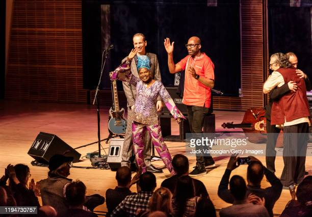 Beninese Jazz and World Music singer and special guest Angelique Kidjo waves as she takes a curtain call with members of the Lionel Loueke Trio after...