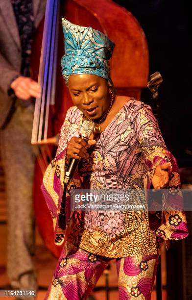 Beninese Jazz and World Music singer Angelique Kidjo performs onstage as a special guest with the Lionel Loueke Trio at Carnegie Hall's Zankel Hall...