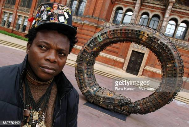 PHOTO Beninese sculptor Romuald Hazoume with his work which forms part of the 'Uncomfortable Truths the shadow of slave trading on contemporary art...