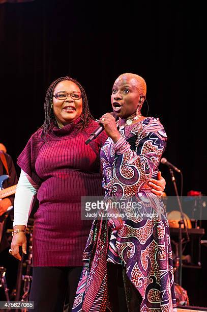 Beninese/American singer Angelique Kidjo introduces Liberian Nobel prizewinning peace activist Leymah Gbowee on stage at Town Hall New York New York...
