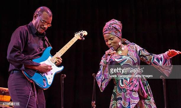 Beninese/American singer Angelique Kidjo with American guitarist Dominic James on guitar performs onstage at Town Hall New York New York February 15...
