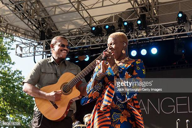 Benineseborn American musician Angelique Kidjo and guitarist Dominic James perform onstage at Central Park SummerStage New York New York June 7 2015
