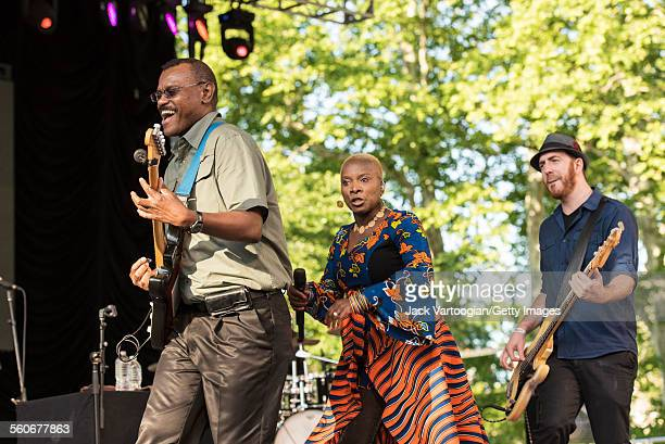 Benineseborn American musician Angelique Kidjo and her band among them guitarist Dominic James and bassist Ben Zwerin perform onstage at Central Park...