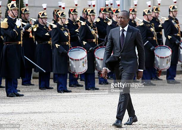 Benin's newly elected President Patrice Talon reviews honor guards prior to attend a meeting with French President Francois Hollande at the Elysee...