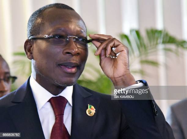 Benin's President Patrice Talon attends the opening of an extraordinary session of the West African Economic and Monetary Union zone on April 10 2017...