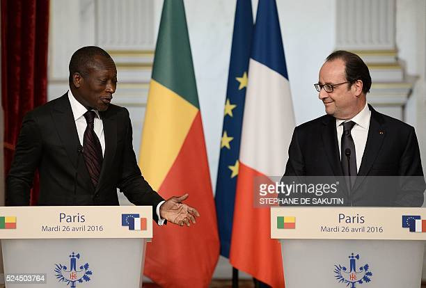 Benin's President Patrice Talon gestures as he delivers a joint statement with French President Francois Hollande at the Elysee Presidential Palace...