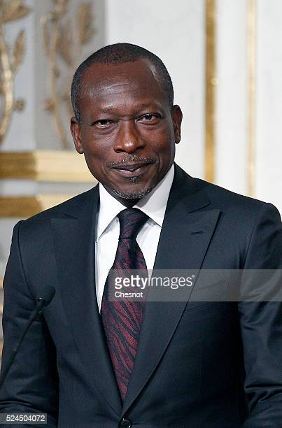 Benin's President Patrice Talon makes a statement during a press conference with French President Francois Hollande at the Elysee Palace on April 26...