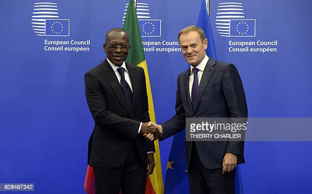 Benin's President Patrice Talon shakes hands with European Union Council President Donald Tusk before their meeting a the European Union Council...