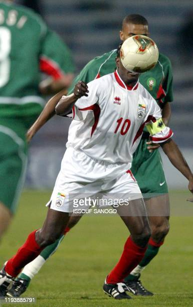 Benin's Tchomogo Oumar heads the ball during their African Nations Cup match against Morocco at the Taeib Mhiri stadium in Sfax, 31 January 2004....