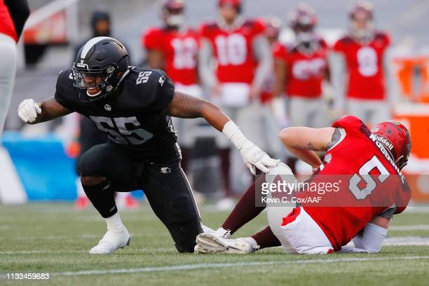 BeniquezBrown of the Birmingham Iron celebrates after sacking LoganWoodside of the San Antonio Commanders during the first half in an Alliance of...