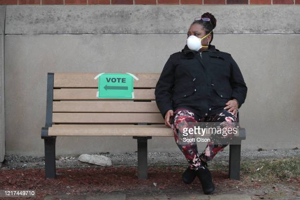 Benita Dills rests after voting at Riverside University High School on April 07 2020 in Milwaukee Wisconsin The voters waited sometimes more than two...