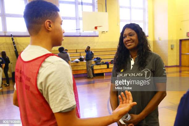 Benita Fitzgerald Mosley CEO Laureus Sport for Good USA speaks with a student during the Laureus Sport for Good NYC Media Site Visit at University...