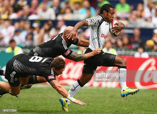 Benito Masilevu of Fiji is tackled during the cup semi final match between New Zealand and Fiji during day three of the 2013 Hong Kong Sevens at Hong...