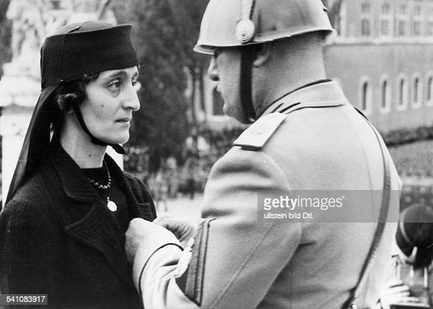 Benito Mussolini *29071883 Politician Italy 19251943/45 dictator of Italy honouring the widow of a dead soldier who fell in the Spanish Civil War at...
