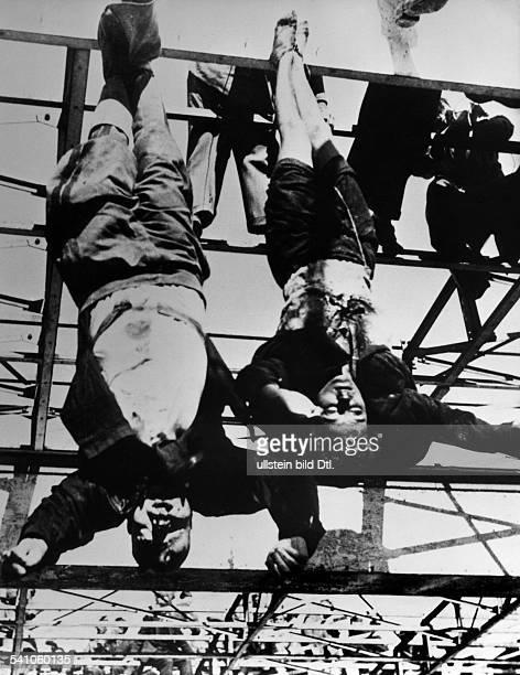 Benito Mussolini *29071883Politiker Italien19251943/45 Diktator ItaliensDie an einer Tankstelle auf dem PiazzaleLoreto in Mailand aufgehängten...
