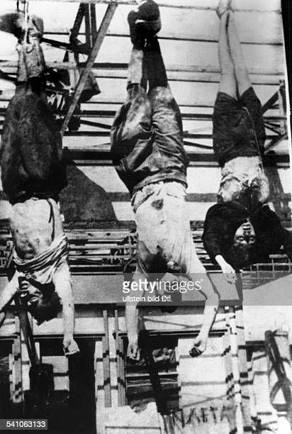 Benito Mussolini *29.07.1883-+Politiker, Italien1925-1943/45 Diktator ItaliensDie an einer Tankstelle auf dem PiazzaleLoreto in Mailand aufgehängten...