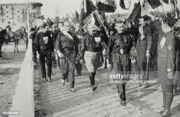 Benito Mussolini accompanied by his chiefs of staff inspecting the 40000 fascists lined up at the sports field in Naples Italy October 24 from...