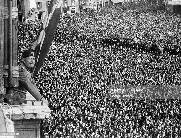 Benito Mussolini addressing crowds on during the Declaration of the Italian Empire May 9 in the Palazzo Venezia in Rome Italy