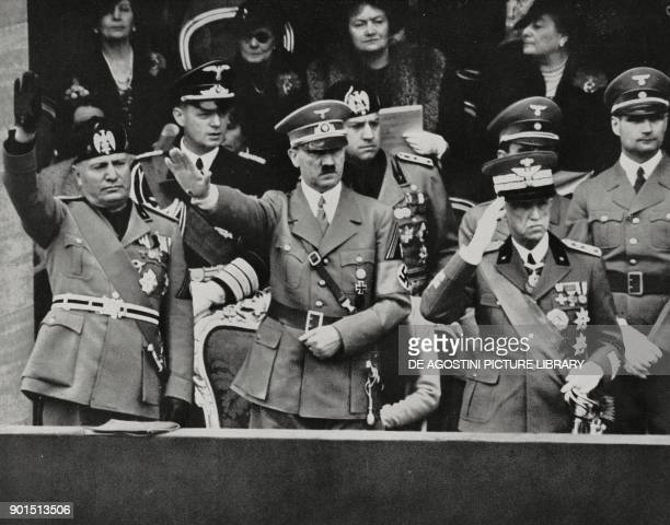 Benito Mussolini Adolf Hitler and Vittorio Emanuele III saluting the parade of the Italian military units Rome Italy from L'Illustrazione Italiana...