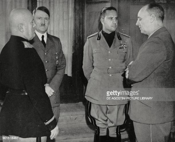 Benito Mussolini Adolf Hitler Joachim von Ribbentrop and Galeazzo Ciano during a meeting at Palazzo Vecchio Florence October 28 Italy World War II...