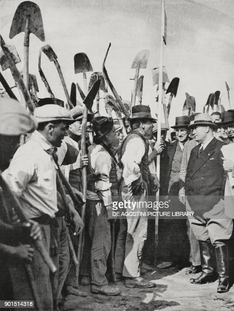 Benito Mussolini among the workers who reclaim the Agro Pontino April 5 Mascarello Latina Italy photo by Bruni from L'illustrazione Italiana year LIX...