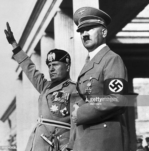 Benito Mussolini and Adolf Hitler watch a Nazi parade staged for the Italian dictators's visit to Germany