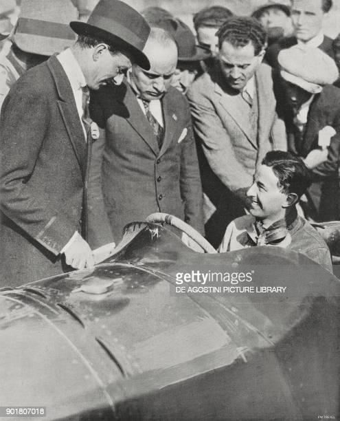 Benito Mussolini and Mr Aldo Finzi with the race car driver Pietro Bordino before the start of the European Grand Prix in Monza Italy September 9...