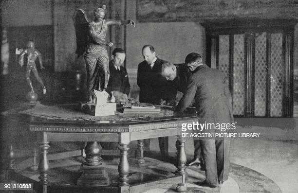 Benito Mussolini and the German ambassador Von Neurath signing the ItaloGerman arbitration treaty Rome Italy December 29 from L'Illustrazione...