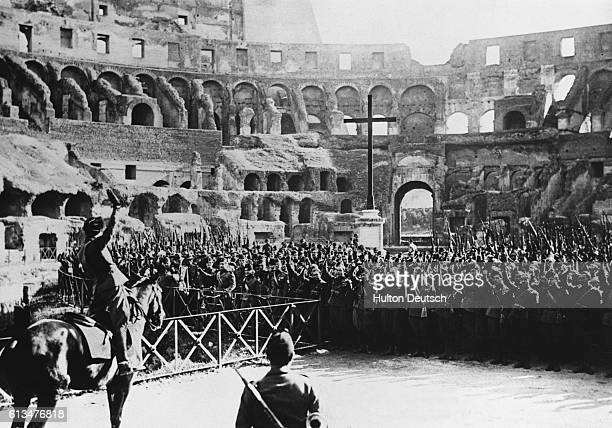 Benito Mussolini celebrates the 8th anniversary of the foundation of the Fascist militia with a large crowd of fascists in the Colosseum Rome Italy...