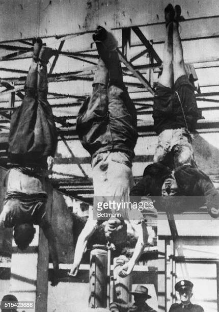 Benito Mussolini, his 33-year-old mistress, Claretta Petacci , and Lt. Gen. Achille Starace , secretary of fascist party, hang from their heels on...