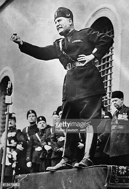 Benito Mussolini Il Duce assumes a characteristic pose as he speaks to an audience in Italy in 1934 Mussolini was widely regarded as a hero and a...