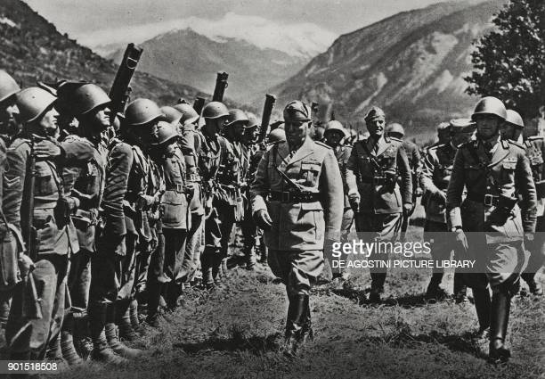 Benito Mussolini inspecting an infantry regiment during his visit to the western front Mont Cenis June 1940 Italy World War II from L'Illustrazione...