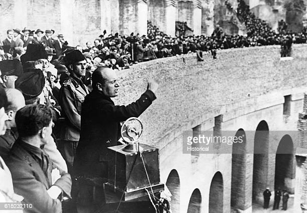 Benito Mussolini Italian dictator and leader of that country's fascist party from 1925 to his deposition in 1943 makes a speech from the second level...