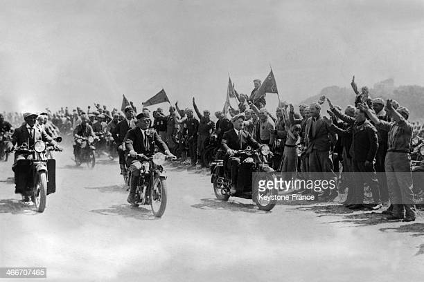 Benito Mussolini on his bike reviewing 10 000 motorcyclists on Via del Impero in Rome Italy in 1933