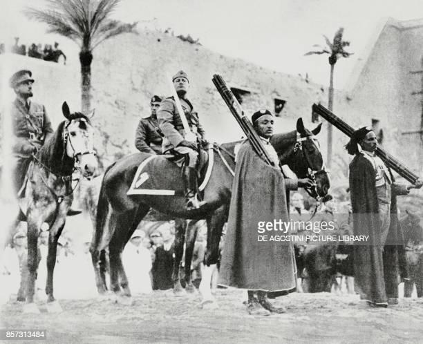 Benito Mussolini on horseback holding the sword of Islam in Tripoli with Italo Balbo on the left Libya from L'Illustrazione Italiana March 28 1937