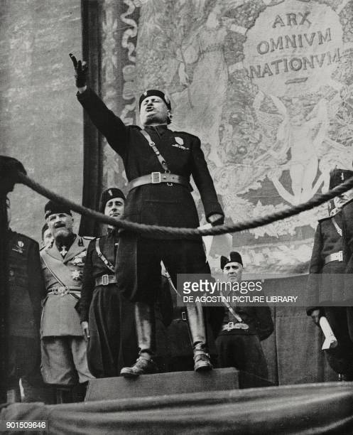 Benito Mussolini on the occasion of the Labor Day invites old Black Shirts to raise gags and rifles to celebrate unity of work with weapons May 1...