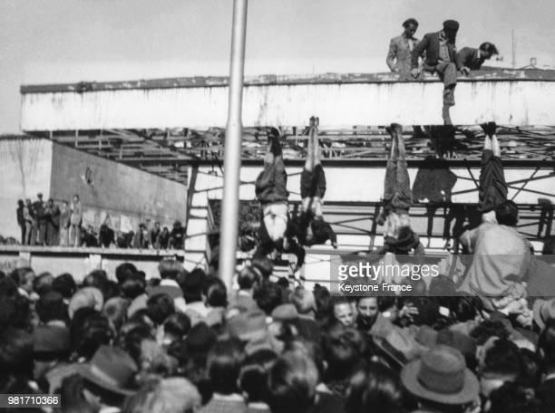Benito Mussolini, sa maîtresse Clara Petacci et 16 autres personnes sont pendus par les pieds après avoir été tués par les Partisans italiens, Place...